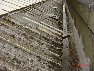 Asbestos cement roof sheets in Cwmbran, confirmed by bulk sampling, 2004