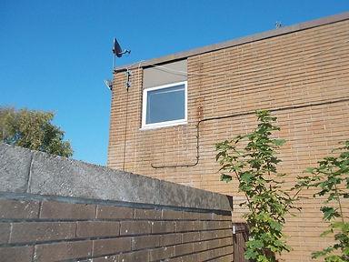 Asbestos cement panel above windowfrom an asbestos demolition survey in Weston-super-Mare, North Somerset, 2015