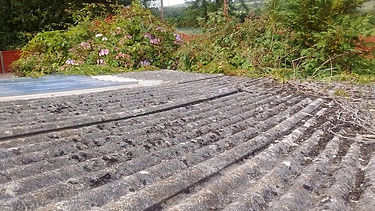 Asbestos cement shed roof sheets in Bryncethin, Bridgend