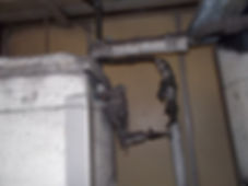 Asbestos paper under non-asbestos pipe lagging from an asbestos management survey in Bridgend Industrial Estate, Bridgend, 2015