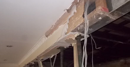 Damaged asbestos insulating board in Canton, Cardiff