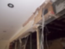 Beam cladding, asbestos insulating board (AIB), in very poor condition in Canton,Cardiff