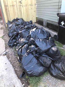Trash bags full of construction debris