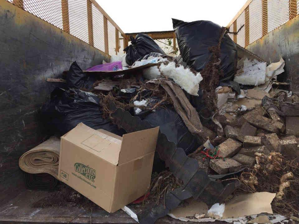 Junk Hauling Dumpster Full of trash