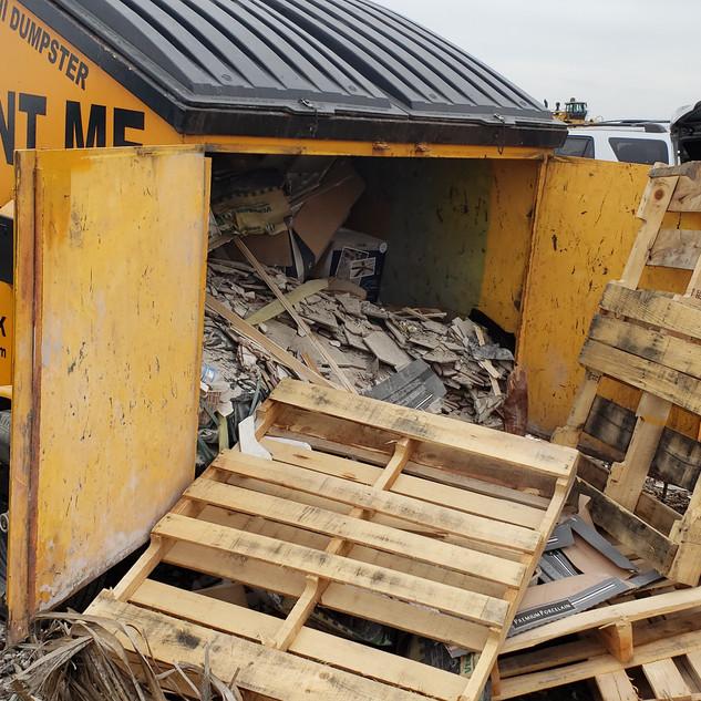 6-yard dumpster full of construction debris