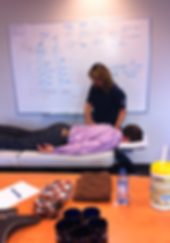 Diane Hoard from Calgary therapeutic massage and wellness performing corporate massage