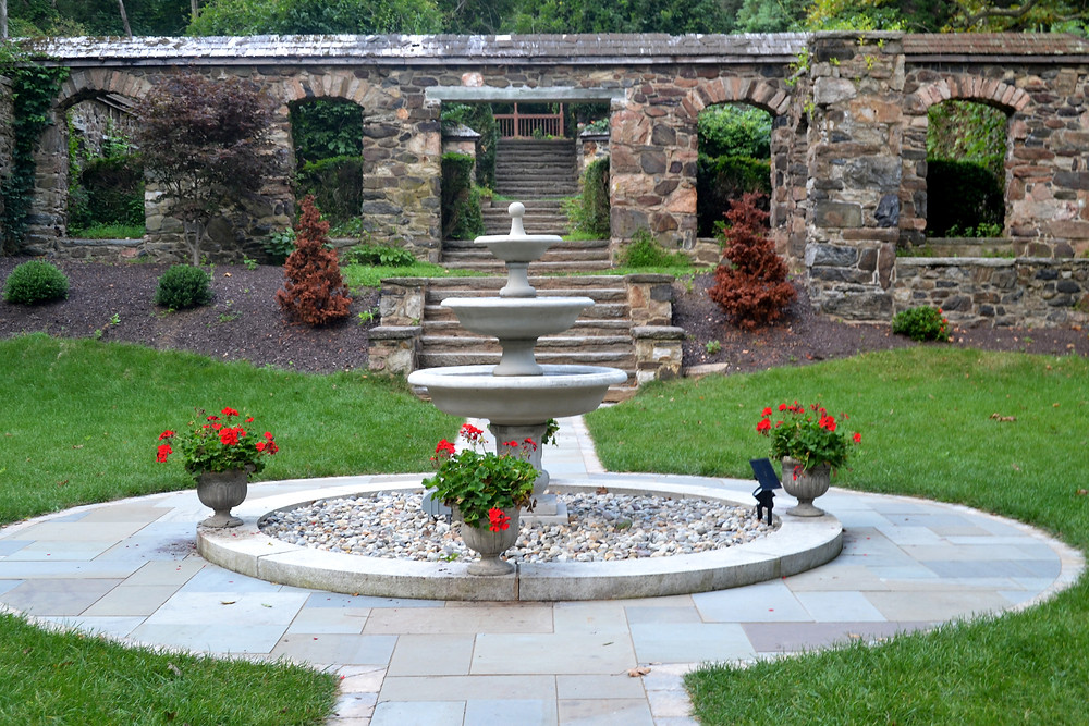 Walk through the stone arches and down the steps towards Hunting Hill Mansion located in Media PA's Ridley Creek State Park.