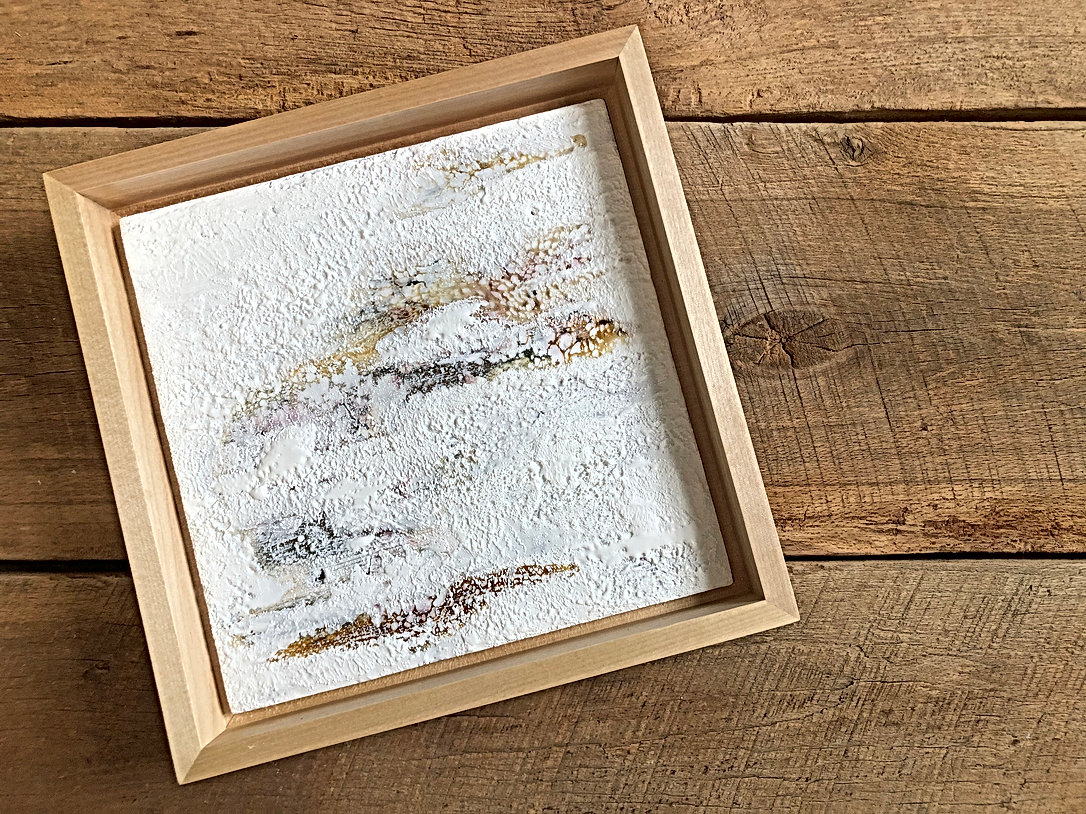 Encaustic painting in wood frame.