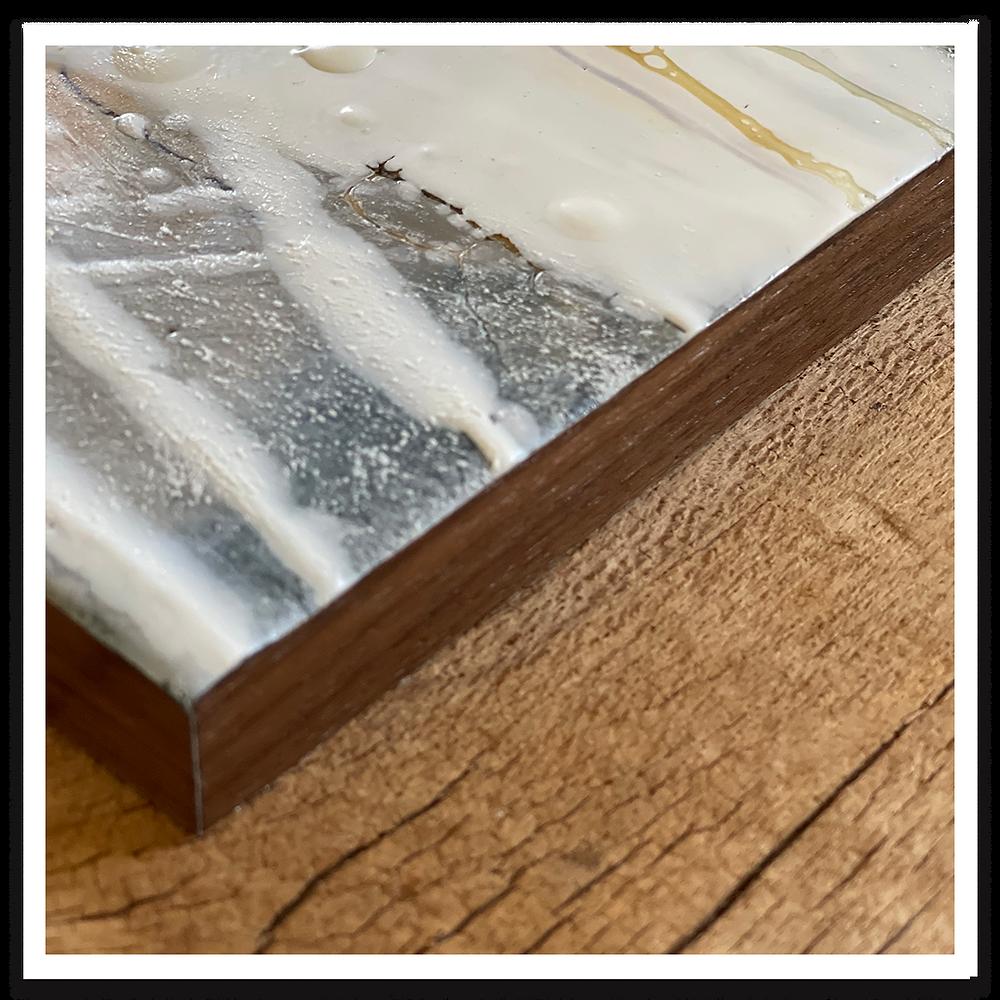 Painting with walnut veneer edge banding