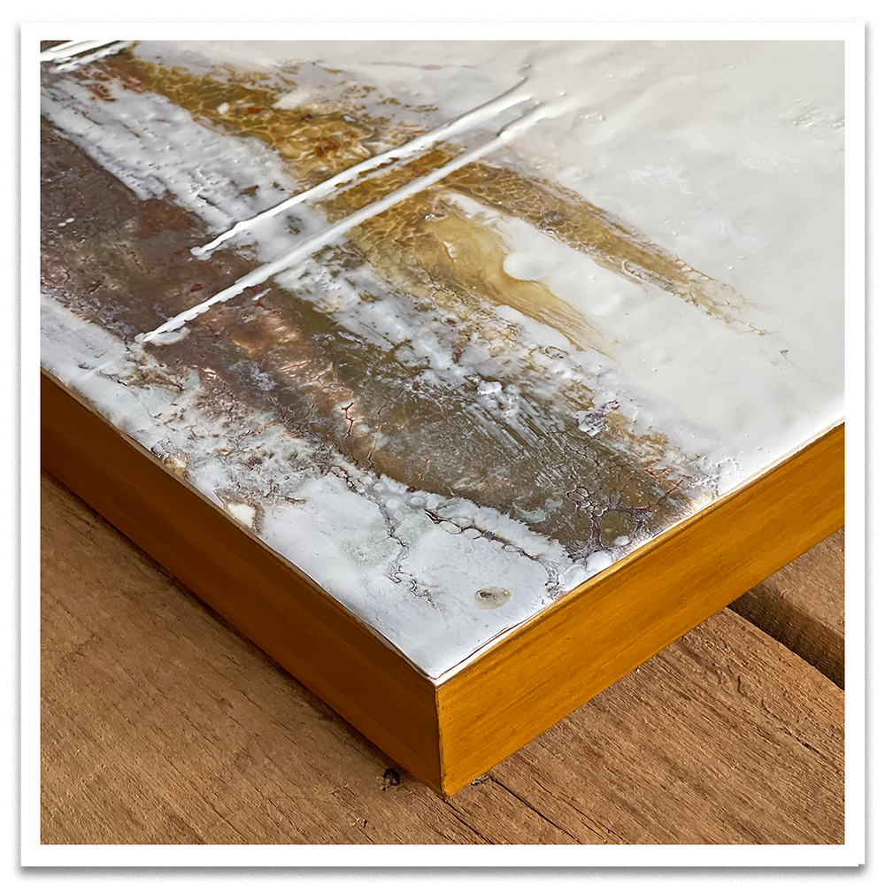 Edge of a painting finished with tinted shellac