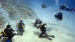 PADI IDC in the Red Sea with clear water and Staff Instructors marking the presentations