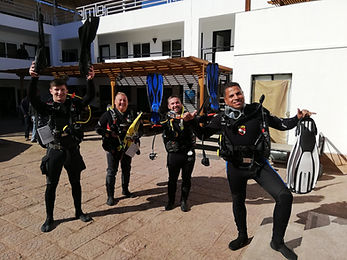 Four PADI Instructors celebrating during their Instructor Exam in the Red Sea