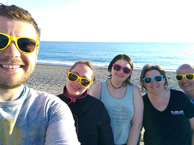 Delighted nw PADI Divemasters on the beach in Spain