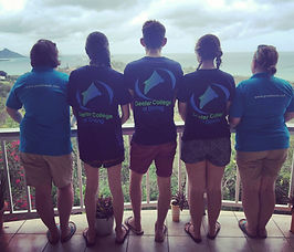 Deefer Diving in Carriacou and their three successful PADI Instructors admiring the view fo the hilltop swimming pool
