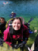 smiling woman scuba diver coming out of the water