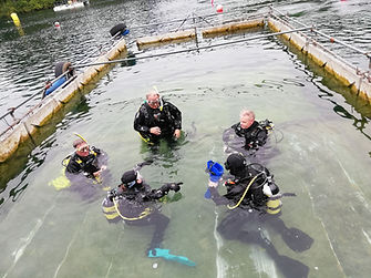 PADI Divemasters working in the confined water area of Vobster Quay during their training.