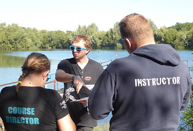 PADI Staff Instructor an PADI Course Director assessing an IDC candidate during an open water presentation
