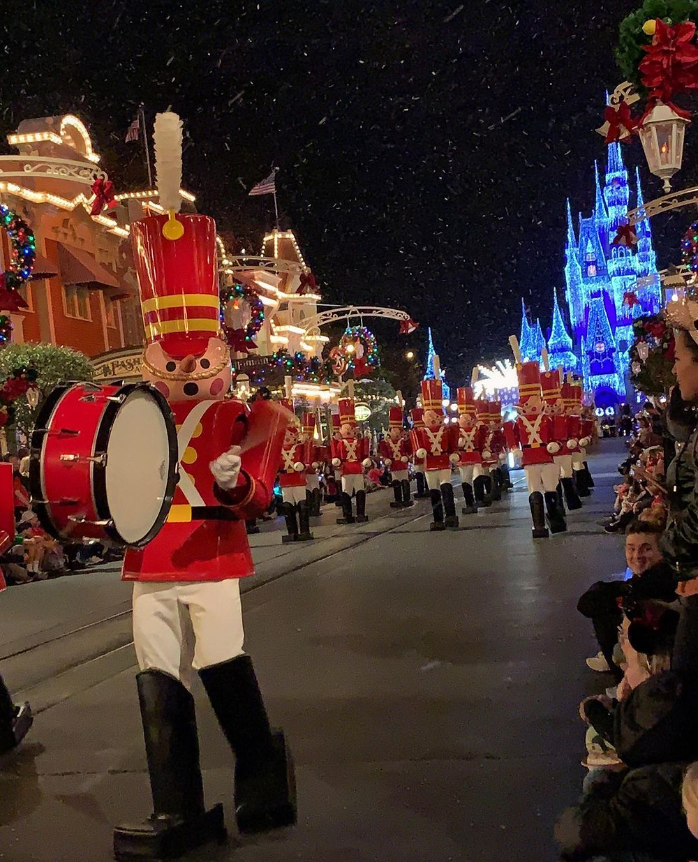 toy soldiers march down main street in the Walt Disney World Holiday Christmas parade