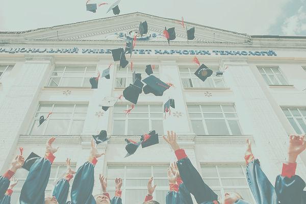 group of fresh graduates students throwi