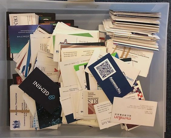 a box full of collected business cards