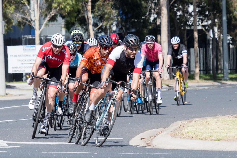 Criterium cyclists racing