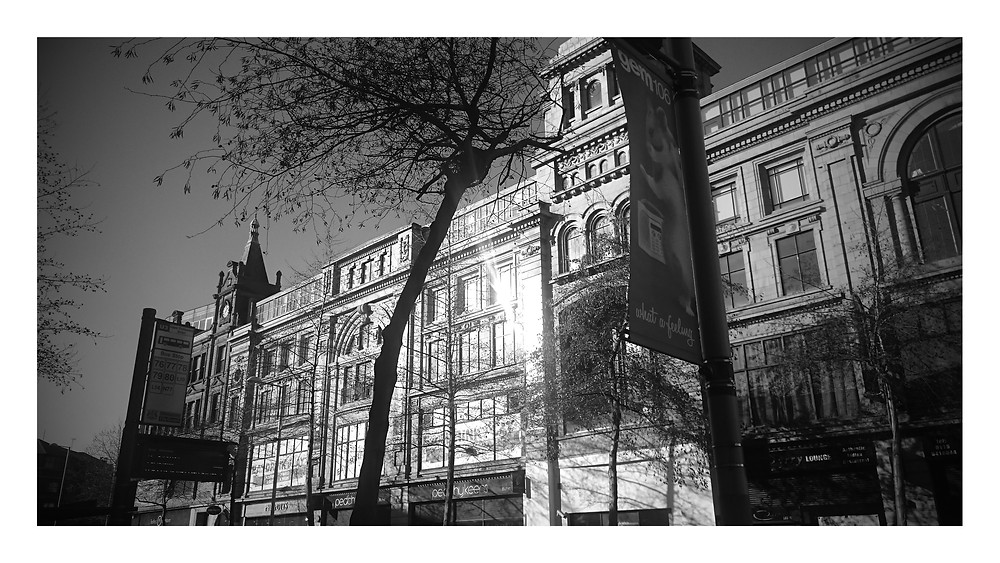 Black and white of a early 20th century building designed by
