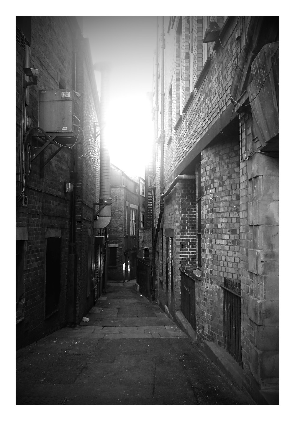 Stylised black and white image of an old alley