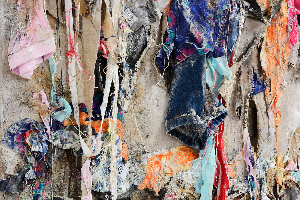 """Aftermath"" (Detail) - a relief made from clothes and fabric, inspired by the Rana Plaza disaster"