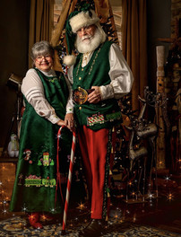 Mrs. C and Santa in Their Santa Train Attire Visit Whistle Stop Toy and Hobbies
