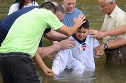 Ruben David being baptized