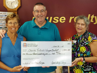 Mom's first check from Neuse Realty.