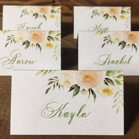 Floral place cards in Bickham Swash lettering style