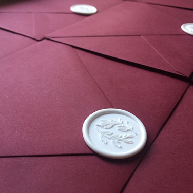 Olive wreath wax seals on envelopes