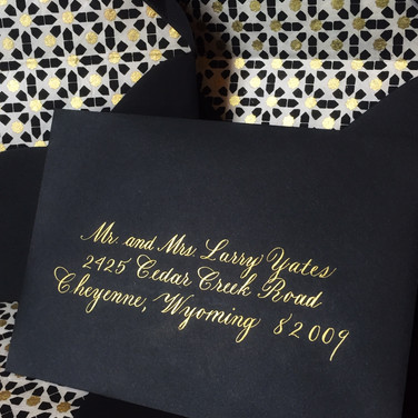 Outer envelopes in Copperplate lettering style with liners in black and gold design