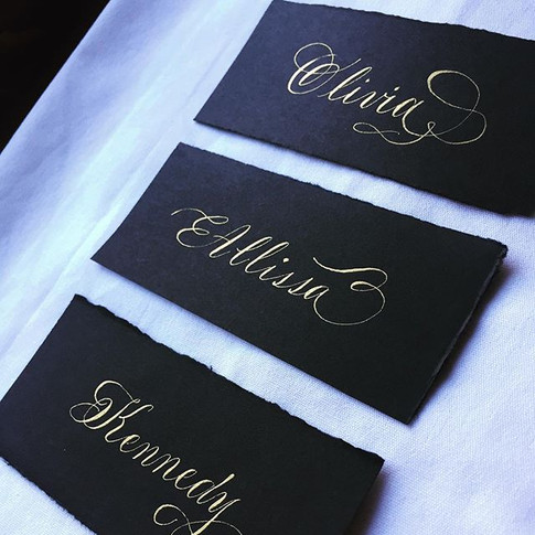 Torn edge place cards in flourished copperplate