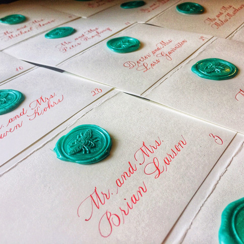 Escort cards in Bickham lettering style
