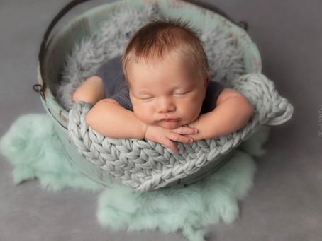 Hoe vind ik een geschikte newborn fotograaf?
