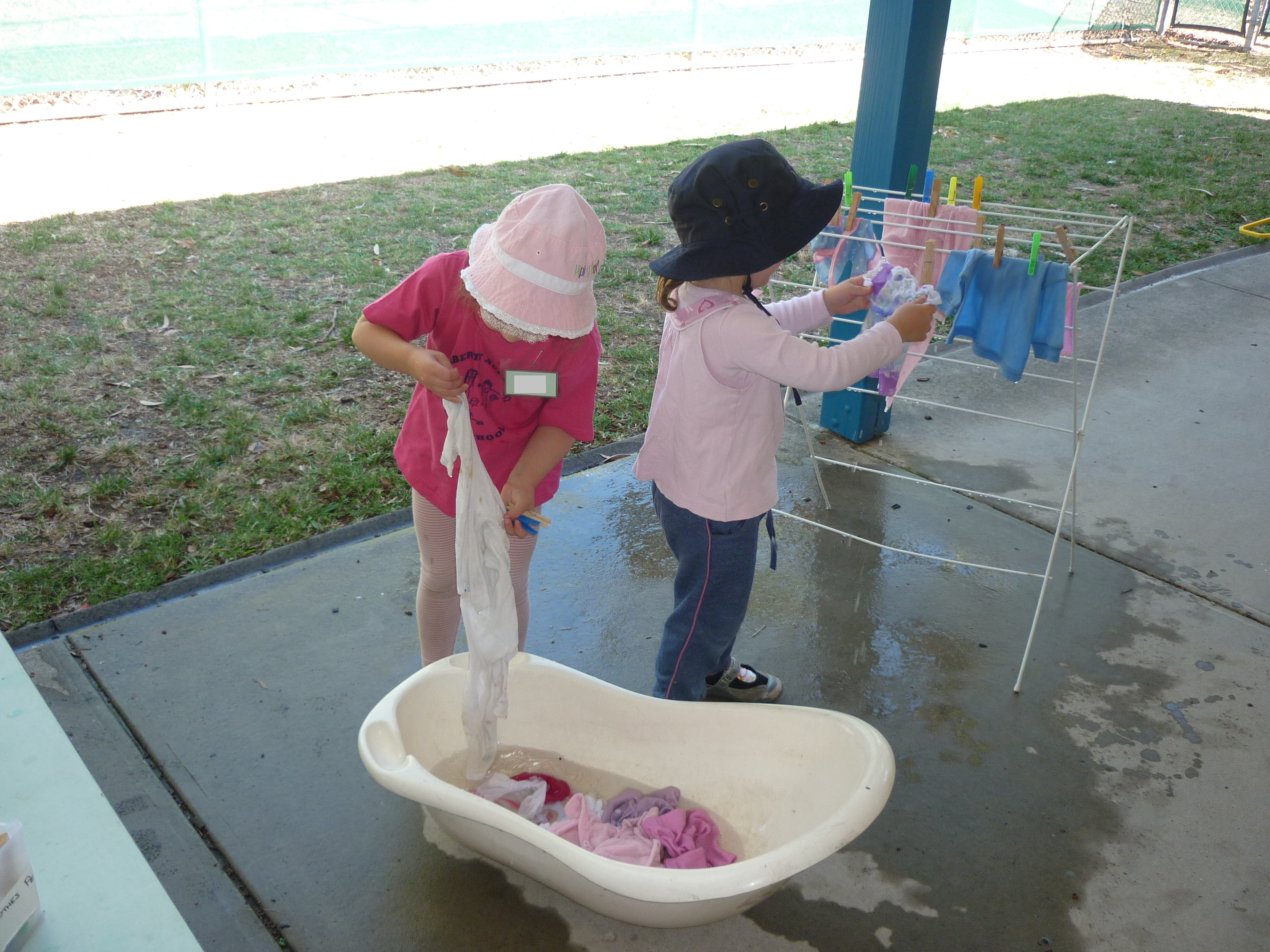 Washing the doll's clothes
