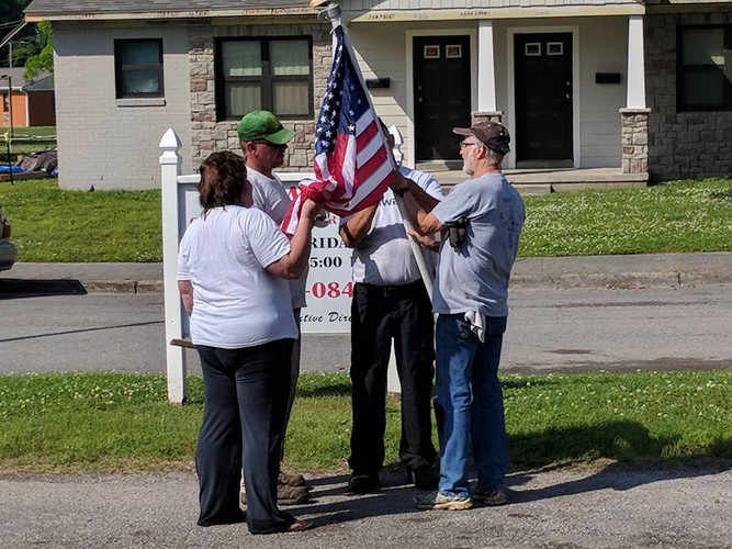 Raising the flag at Gallatin Daycare