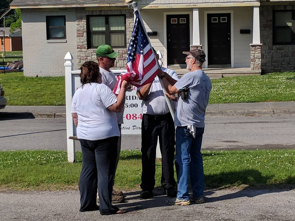 Raising the flag at Gallatin Daycare