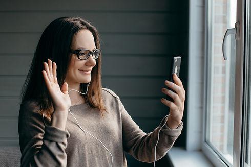Happy brunette woman in glasses making f