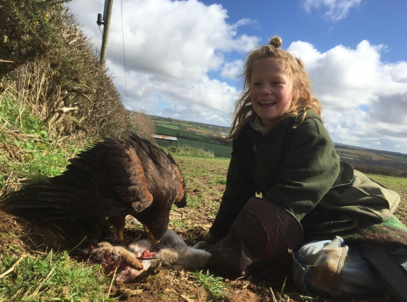 My ten year old son Tawny ,the under falconer, is all smiles after Yarak catches a buck rabbit