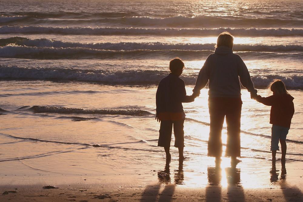 Parent and children on beach