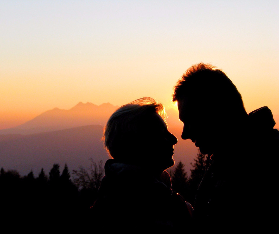 Couple in relationship and sunset over mountain