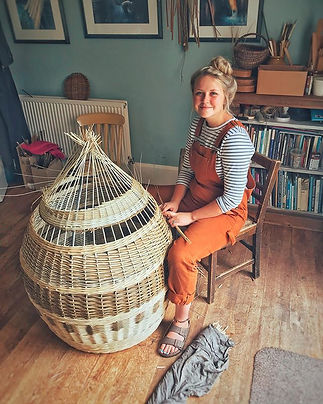 Basketmaker, Willow Weaver Issy WIleks making a woven lampshade