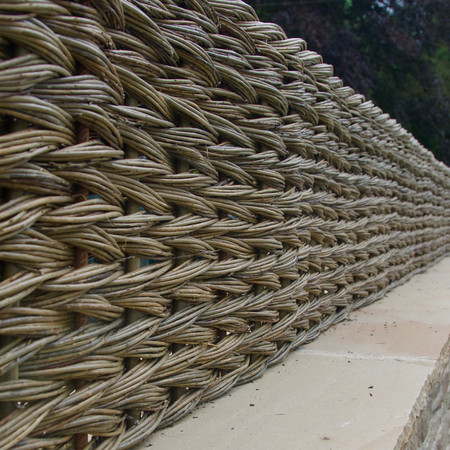 Dry Willow fence, Private Commission, Herefordshire 2017 Willow Fencing, Hurdles and Panels. Sustainable, handmade and harvested wicker fencing by Professional Basketmakers Jenny Crisp and Issy Wilkes, Willow with Roots