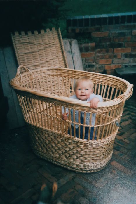 Baby Issy in white willow basket, The beginning of Willow with roots - traditional basketmakers