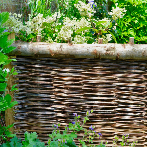 Willow Fencing, Hurdles and Panels. Sustainable, handmade and harvested wicker fencing by Professional Basketmakers Jenny Crisp and Issy Wilkes, Willow with Roots, Chestnut Hurdle