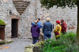 A tour being lead at Buittle Castle