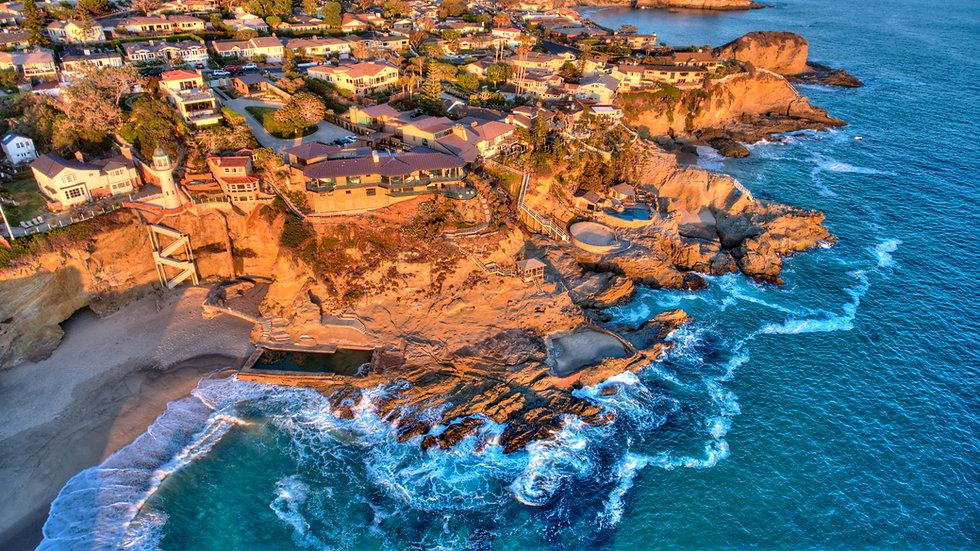 Aerial view of Three Arch Bay in Laguna Beach, Orange County, California during twilight..